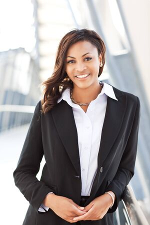 african american woman business: A shot of a beautiful black businesswoman outdoor