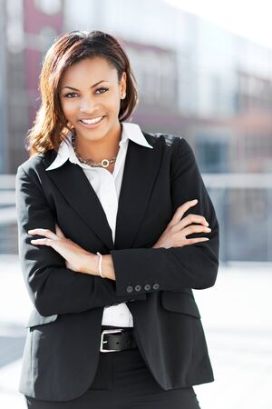 A shot of a beautiful black businesswoman outdoor Stock Photo - 7773599