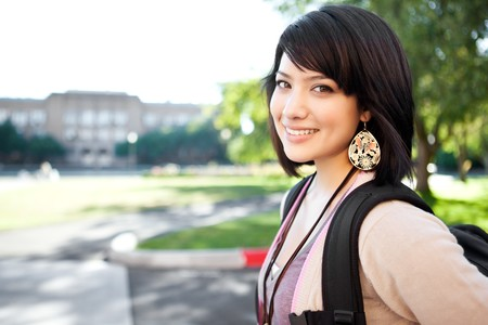 school campus: A portrait of a mixed race college student at campus Stock Photo