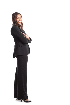 business woman standing: An isolated shot of a happy black businesswoman