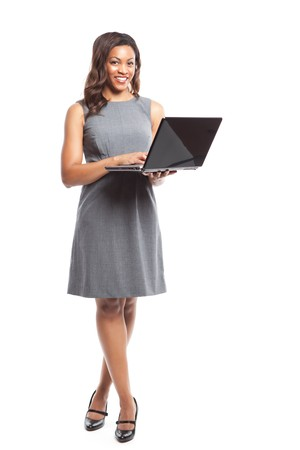 laptop: An isolated shot of a black businesswoman holding a laptop