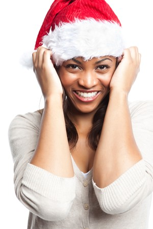 An isolated shot of a black woman celebrating christmas wearing santa hat photo