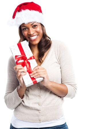 A black woman celebrating christmas carrying a gift box photo