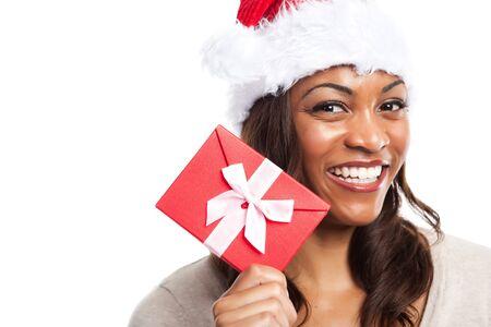 A black woman celebrating christmas holding a gift box photo