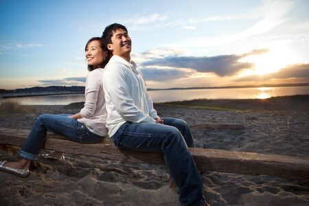 A portrait of an asian couple having fun outdoor photo