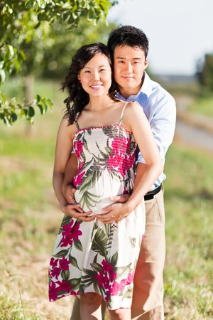 korean woman: A portrait of a pregnant wife with her husband