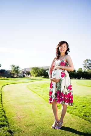A portrait of a pregnant asian woman outdoor photo