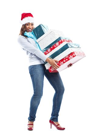 A black woman celebrating christmas carrying gift boxes photo