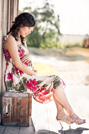 A portrait of a pregnant asian woman outdoor Stock Photo - 7893652