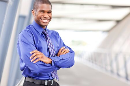 A portrait of a smiling black businessman outdoor Stock Photo - 7893655