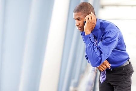 A shot of a black businessman on the phone Stock Photo - 7893657