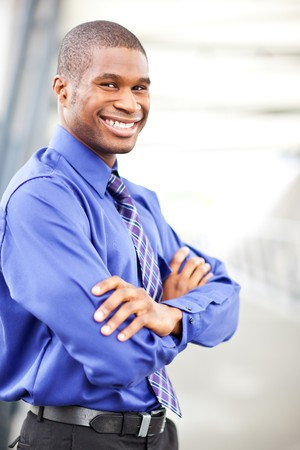 A portrait of a smiling black businessman outdoor Stock Photo - 7893661
