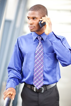 mobile communication: A shot of a black businessman on the phone Stock Photo