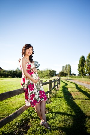 A portrait of a pregnant asian woman outdoor Stock Photo - 7893669