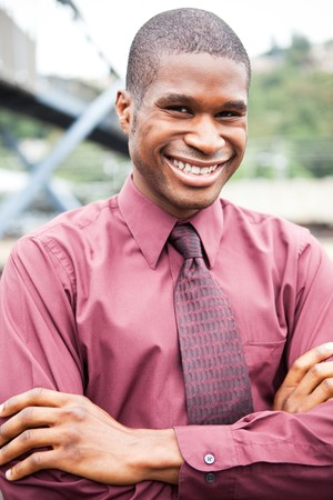 A portrait of a smiling black businessman outdoor Stock Photo - 7893688