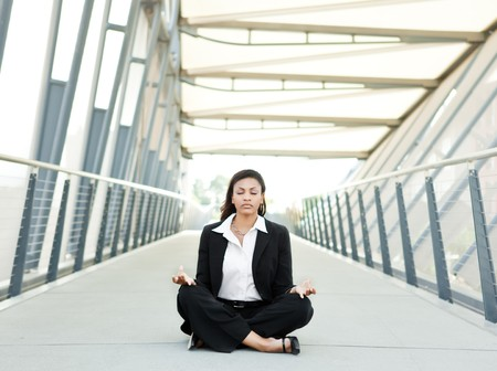 A shot of a beautiful black businesswoman meditating photo