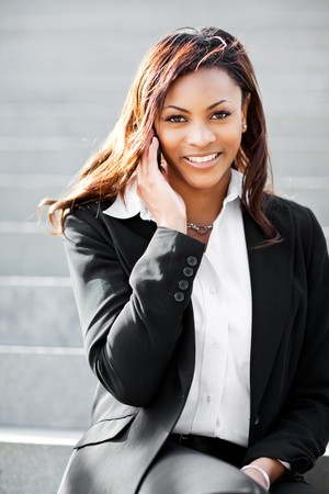mobile communication: A shot of a beautiful black businesswoman on the phone