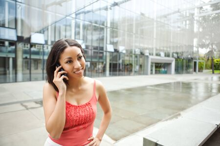 A shot of a mixed race woman talking on the phone Stock Photo - 8004386