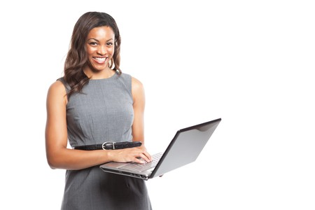 An isolated shot of a black businesswoman holding a laptop photo