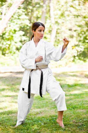 A shot of an asian woman practicing karate