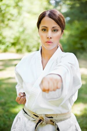 A shot of an asian woman practicing karate photo