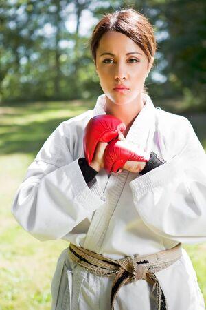 A shot of an asian woman practicing karate photo