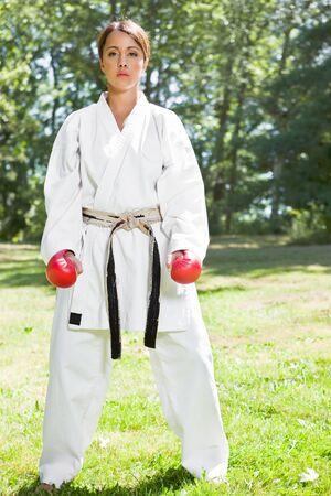 A shot of an asian woman practicing karate Banco de Imagens - 8004403