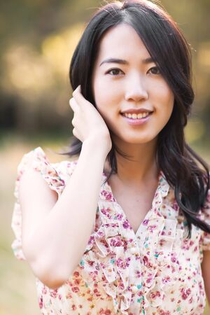 A portrait of a beautiful asian woman outdoor Stock Photo - 8004411