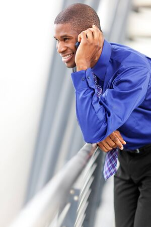 A shot of a black businessman on the phone Stock Photo - 8066325