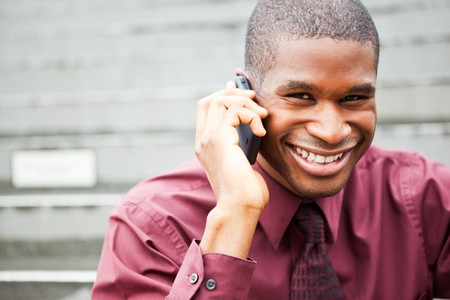 A shot of a smiling black businessman on the phone Stock Photo - 8066330
