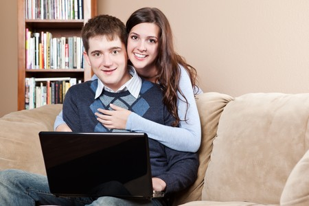A shot of a young couple working on laptop at home Stock Photo - 8135787