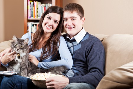 A couple sitting on sofa relaxing at home Stock Photo - 8135792