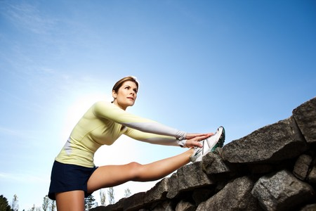 exercise: A beautiful caucasian woman doing exercise outdoor in a park