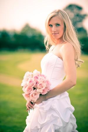 bridal bouquet: A shot of a beautiful caucasian bride outdoor