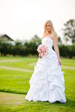 A shot of a beautiful caucasian bride outdoor