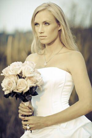 A shot of a beautiful caucasian bride outdoor photo