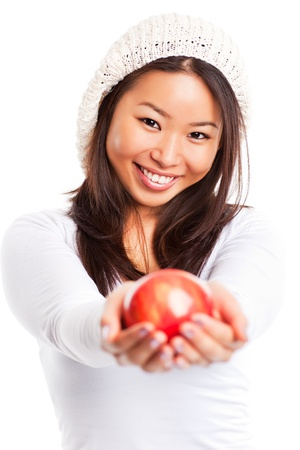 An isolated shot of an asian girl eating apple photo