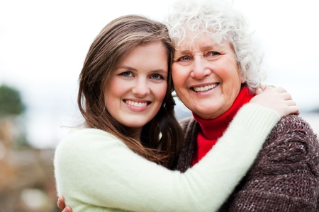 A portrait of a happy teen  granddaughter with her grandmother Stock Photo - 8437125