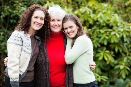 mature old generation: A multi generation portrait of a happy grandmother with her daughter and granddaughter Stock Photo