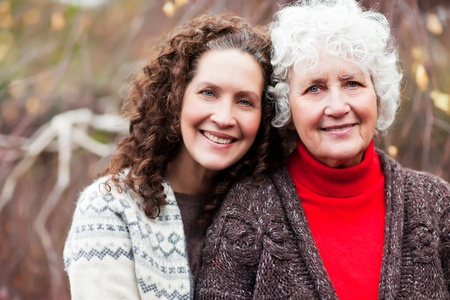 multi generation: A portrait of a happy senior woman with her adult daughter