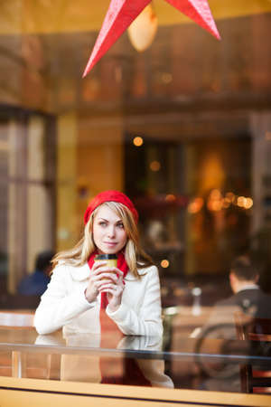 A shot of a beautiful caucasian woman drinking coffee at a cafe Stock Photo - 8597419