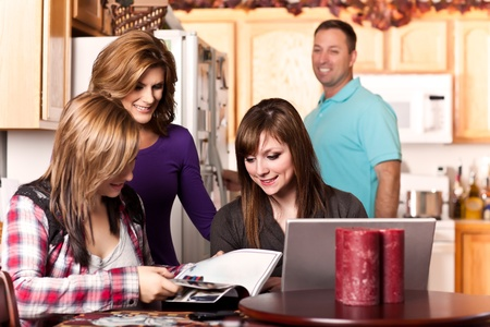 adult magazines: A shot of a caucasian family spending time at home