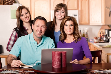 A shot of a caucasian family spending time at home photo