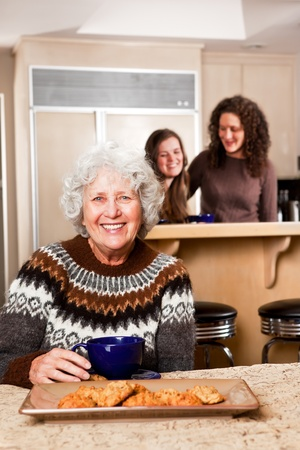 three generations of women: A portrait of a senior lady at home with her daughter and granddaughter