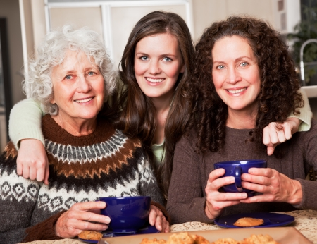 A multi generation portrait of a happy grandmother with her daughter and granddaughter spending time together 스톡 콘텐츠