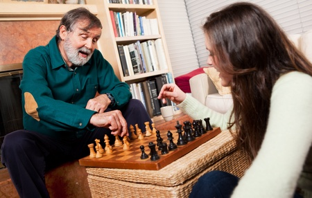 grandkids: Senior playing chess Stock Photo
