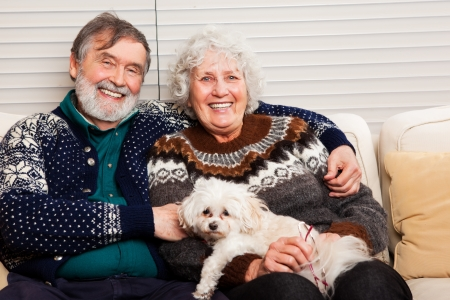 A portrait of a happy senior couple at home photo