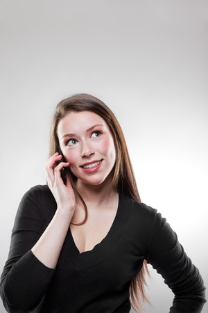 A shot of a beautiful caucasian businesswoman talking on the phone Stock Photo - 8712485