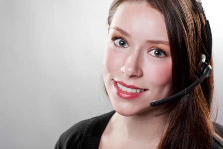 A shot of a beautiful caucasian businesswoman wearing a headset photo
