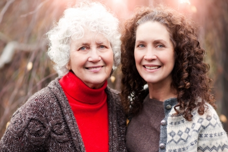 A portrait of a happy senior woman with her adult daughter photo